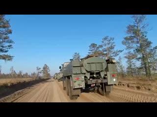 Движение колонны техники РХБ защиты в район паводка в Иркутской области
