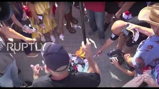 USA: Protesters burn masks at Florida rally