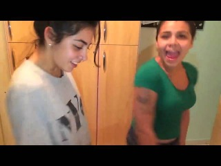 Two girls dancing and fooling around