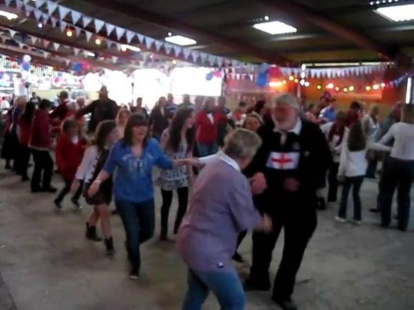 Dancing the traditional English Folk Dance: Farmer s Jig at a Royal Wedding Party