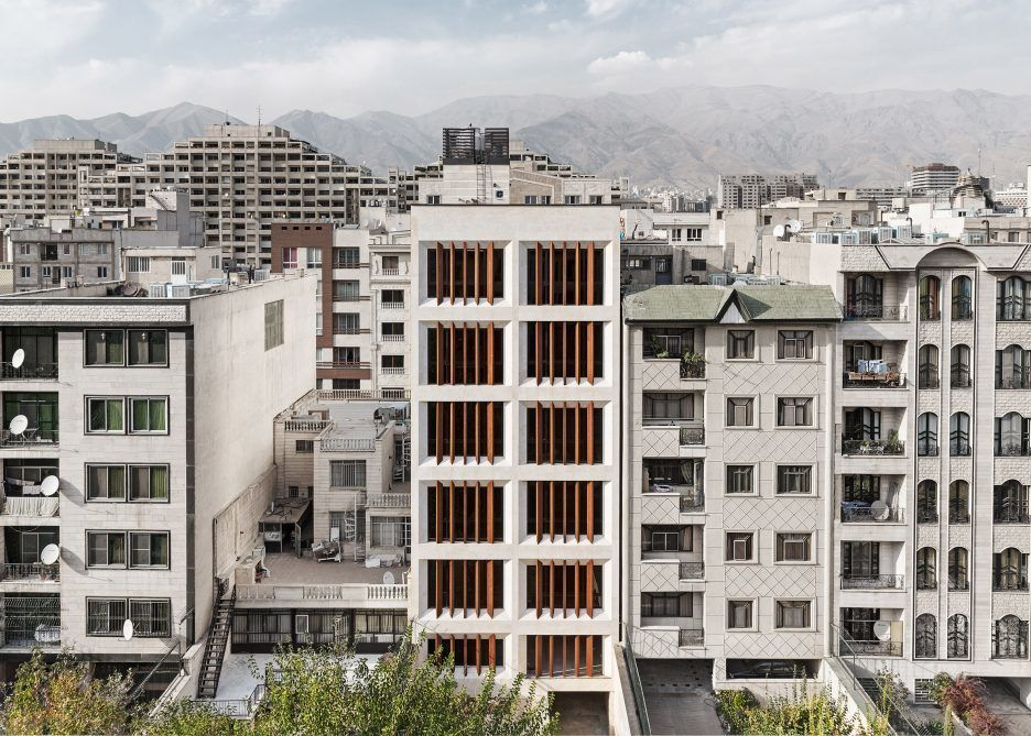 Tehran office building by AWE Office features faceted windows and louvres
